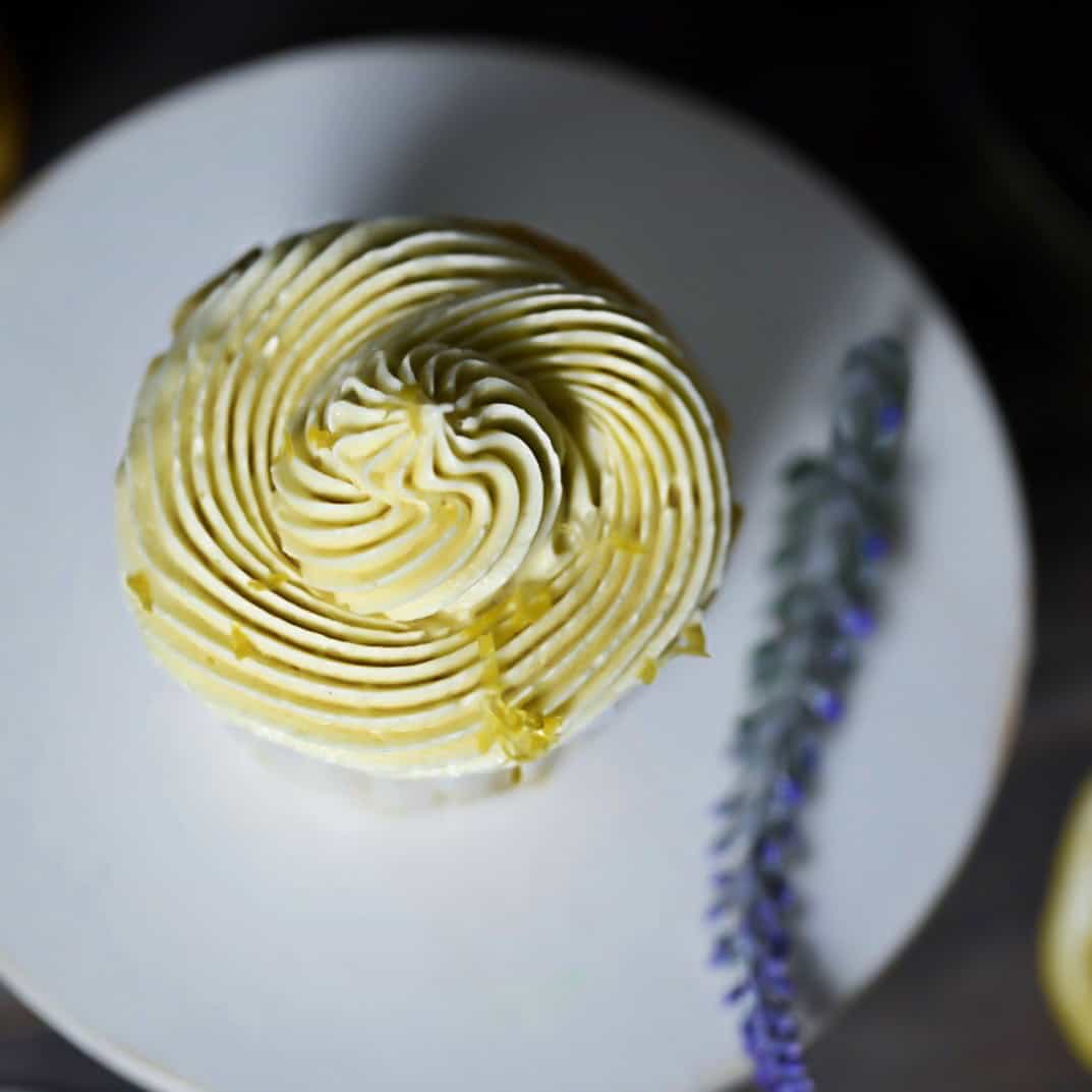 low carb lemon cupcake above shot frosting