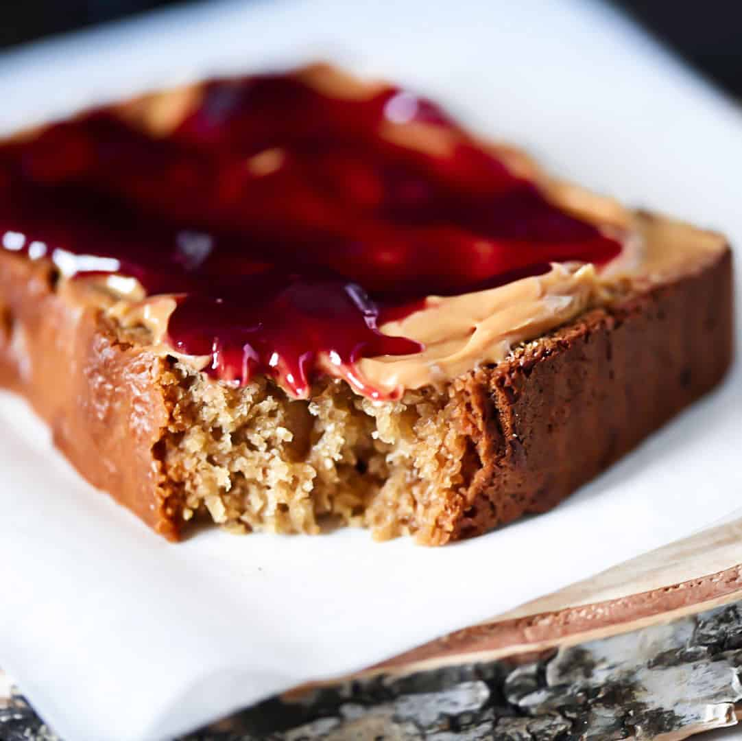 Closeup Peanut Butter Bread with jam on wooden board