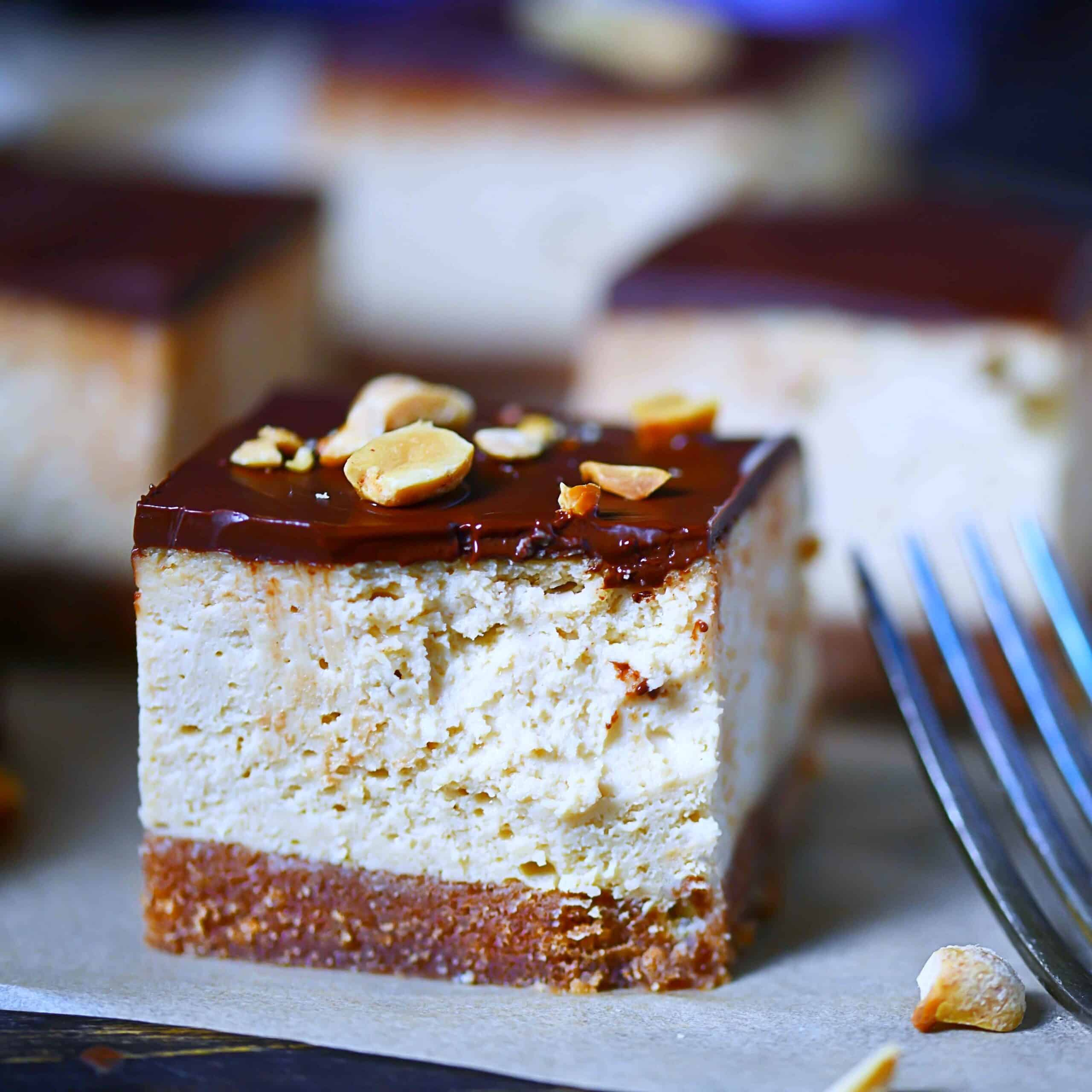 Closeup photo low-carb peanut butter cheesecake with peanuts