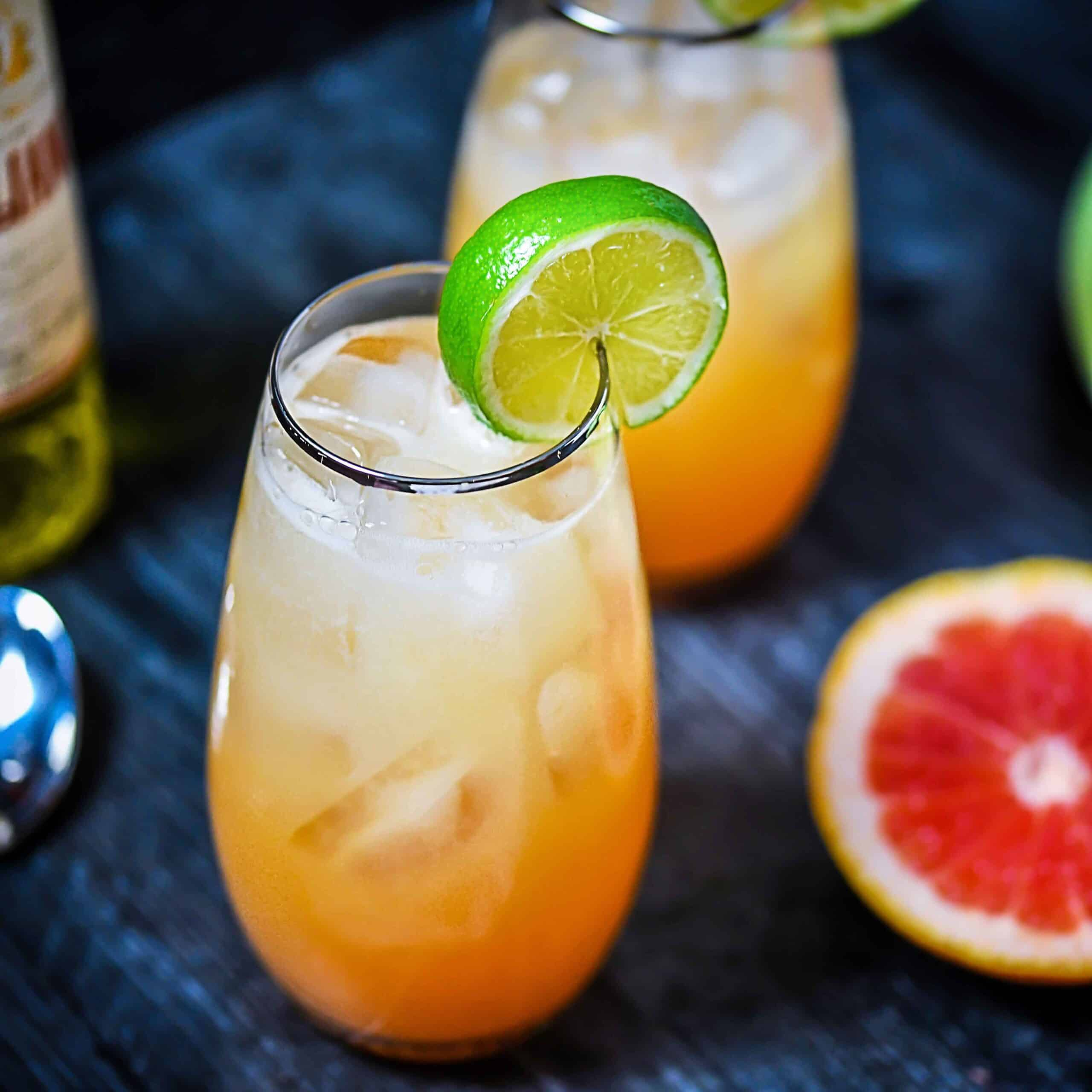 Tequila Wallbanger cocktails with lime wedges