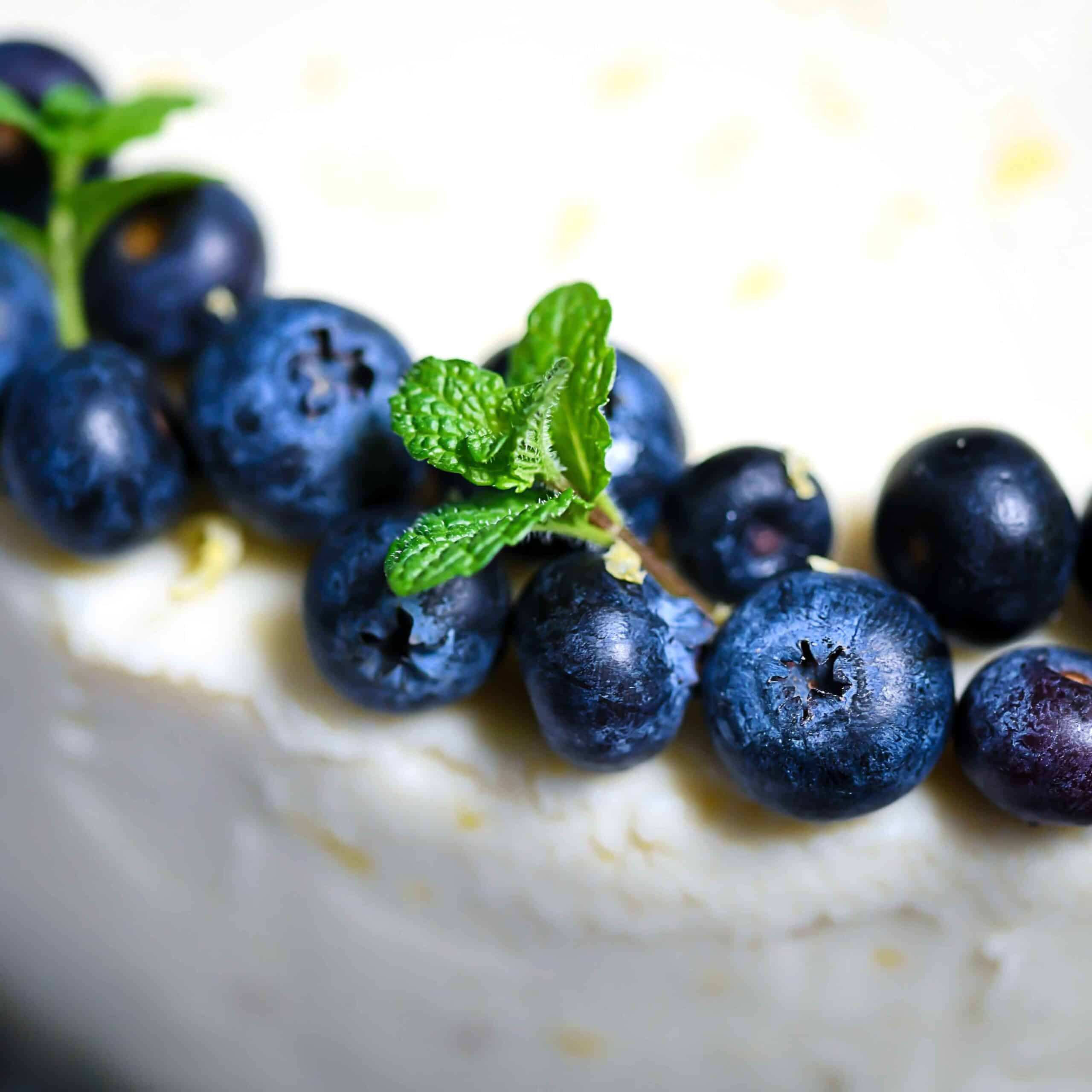 Closeup Blueberries, Mint on lemon cream cheese frosting